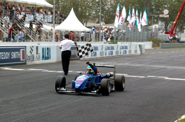 2002 French Formula Three ChampionshipAlbi, France. 8th September 2002Tristan Gommendy (ASM ELF), takes the chequered flag.World Copyright: Aubard/DPPI/LAT Photographicref: Digital Image Only