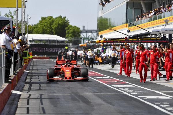 Pole Sitter Sebastian Vettel, Ferrari SF90 drives through the pit lane celebrating with his team