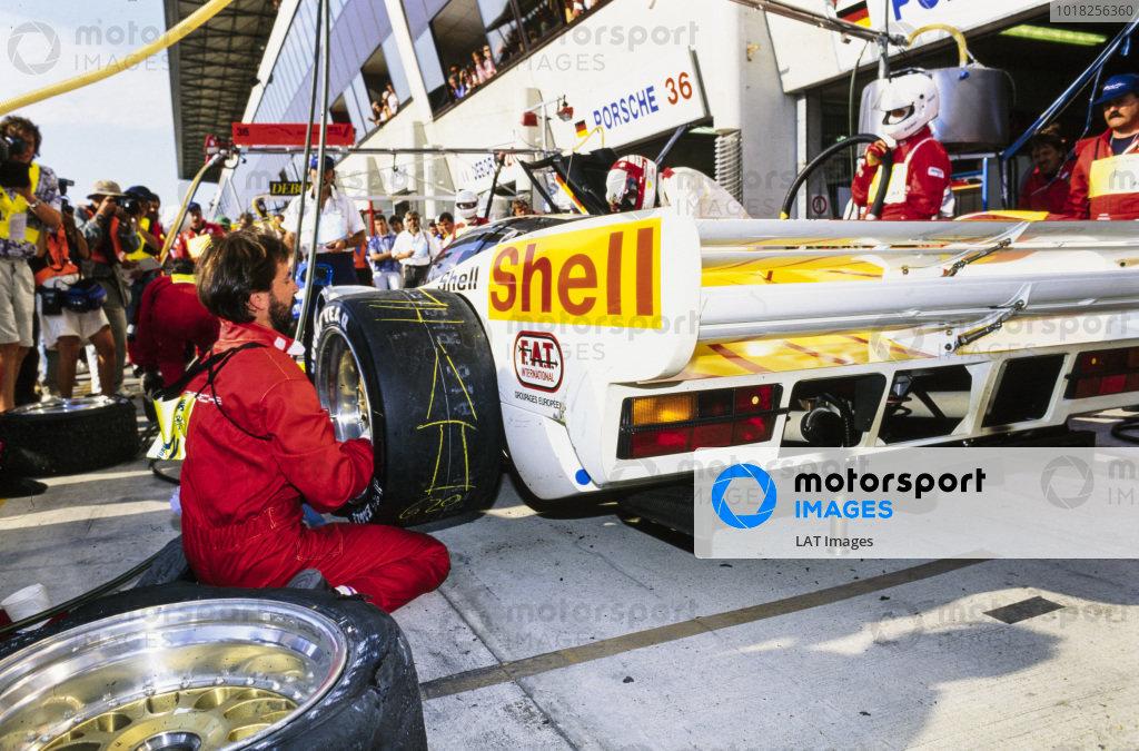 Hans-Joachim Stuck Jr / Danny Sullivan / Thierry Boutsen, Le Mans Porsche Team, Dauer Porsche 962 GT LM - Porsche 935/82, makes pit stop and wheel change.