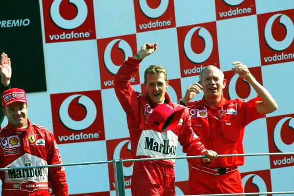 Rubens Barrichello (BRA) Ferrari winner; Michael Schumacher (GER) Ferrari second; Rory Byrne (RSA) Ferrari Chief Designer.Italian Grand Prix Race, Monza, 15 September 2002.DIGITAL IMAGE