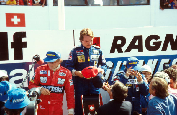 Dijon-Prenois, France.27-29 August 1982.Keke Rosberg (Williams Ford) 1st position, Alain Prost (Equipe Renault) 2nd position and Niki Lauda (McLaren Ford) 3rd position on the podium.Ref: 82SWI05. World Copyright - LAT Photographic