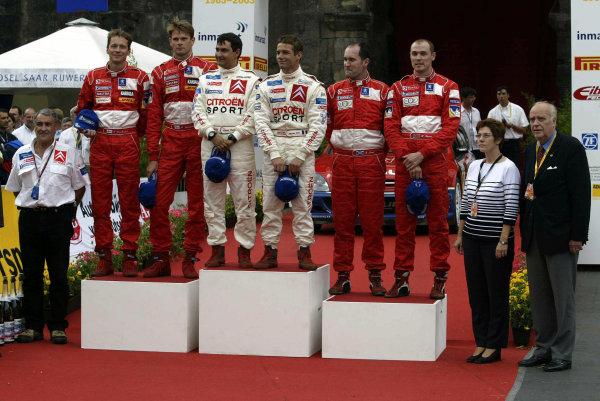 2003 FIA World Rally Champs. Round eight, Deutschland Rally24th-27th July 2003.Sebastien Loeb, Citroen,podium. World Copyright: McKlein/LAT