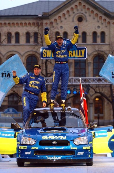 (L to R): Rally winners Phil Mills (GBR) and Petter Solberg (NOR) Subaru celebrate victory on the podium.World Rally Championship, Rd2, Swedish Rally, Day Three, Karlstad, Sweden, 13 February 2005.DIGITAL IMAGE