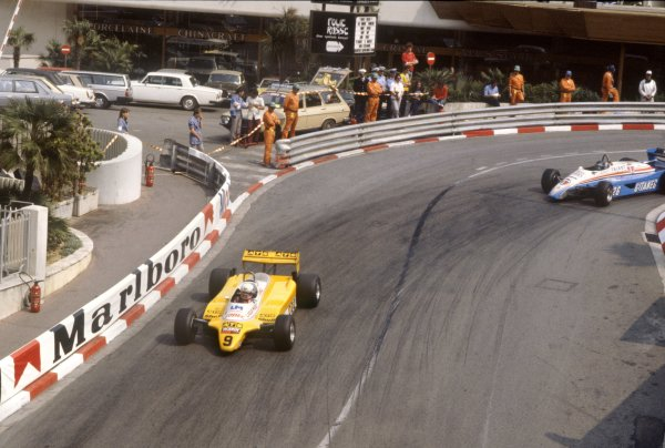 1982 Monaco Grand Prix.Monte Carlo, Monaco. 23 May 1982.Manfred Winkelhock, ATS D5-Ford, retired, leads Jacques Laffite, Ligier JS19-Matra, retired, action.World Copyright: LAT PhotographicRef: 35mm transparency 82MON