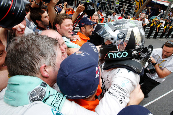 Monte Carlo, Monaco. Sunday 25 May 2014. Nico Rosberg, Mercedes AMG, 1st Position, celebrates with his team in Parc Ferme. World Copyright: Charles Coates/LAT Photographic. ref: Digital Image _J5R3916