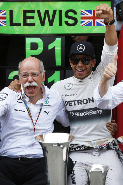 Circuit de Catalunya, Barcelona, Spain. Sunday 11 May 2014. Dr Dieter Zetsche, CEO, Mercedes Benz, and Lewis Hamilton, Mercedes AMG, 1st Position, celebrate. World Copyright: Charles Coates/LAT Photographic. ref: Digital Image _N7T1326