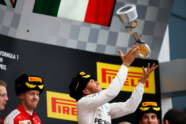 Sochi Autodrom, Sochi, Russia. Sunday 11 October 2015. Lewis Hamilton, Mercedes AMG, 1st Position, tosses his trophy in the air on the podium. World Copyright: Alastair Staley/LAT Photographic ref: Digital Image _R6T2446