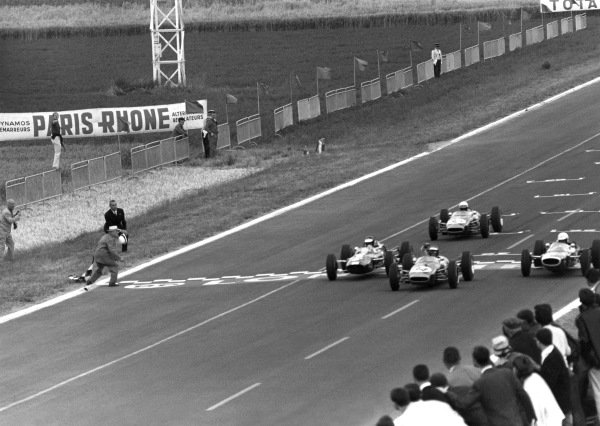 1965 Reims Formula 2 Grand Prix. Reims-Gueux, France. 4th July 1965. Jochen Rindt (Brabham BT16 - Cosworth), 1st position, takes the chequered flag just in front of Frank Gardner (Lola T60 - BRM), 2nd position, Jim Clark (Lotus 35 - Cosworth), 3rd position and Alan Rees (Brabham BT16 - Cosworth), 4th position, action.  World Copyright: LAT Photographic.  Ref:  Autosport Print.