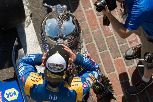 30 May, 2016, Indianapolis, Indiana, USA Alexander Rossi with Borg-Warner wreath and trophy on yard of bricks  ?2016, Scott R LePage  LAT Photo USA