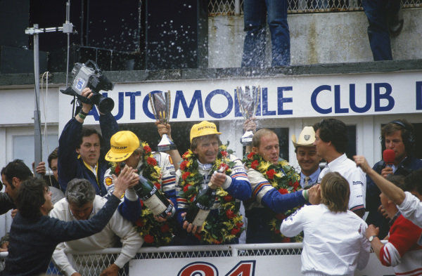 Le Mans, France. 31st May - 1st June 1986.Hans-Joachim Stuck /Derek Bell /Al Holbert (Porsche 962C), 1st position, podium, portrait. World Copyright: LAT PhotographicRef: 86LM