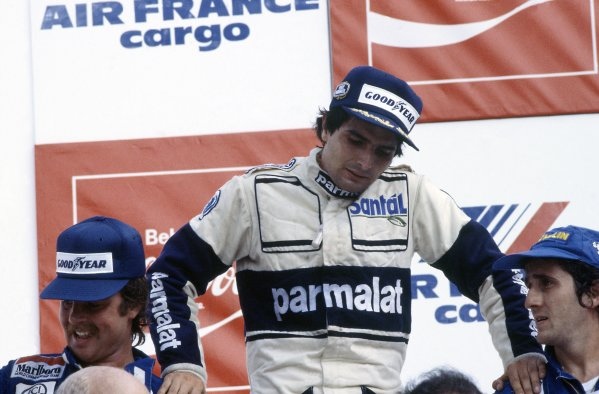 1982 Brazilian Grand Prix.Rio de Janeiro, Brazil. 19-21 March 1982.Nelson Piquet (Brabham BT49D-Ford Cosworth) rests on Keke Rosberg (left, Williams FW07C-Ford Cosworth) and Alain Prost (Renault RE30B) on the podium. Piquet and Rosberg were subsequently disqualified for having underweight cars, promoting Prost to 1st position.World Copyright: LAT PhotographicRef: 35mm transparency 82BRA33