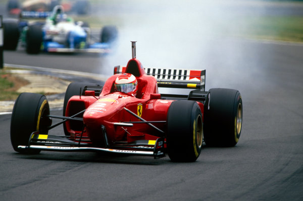 Silverstone, England.12-14 July 1996.Eddie Irvine (Ferrari F310) retires with engine failure, action.World Copyright - LAT Photographic.Ref: 96GB33.