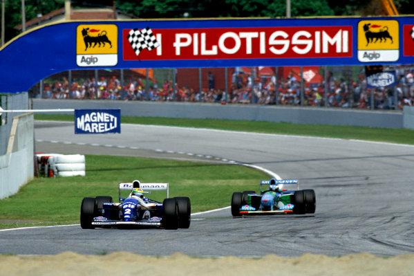 1994 San Marino Grand Prix. Imola, Italy. 29/4-1/5 1994. Ayrton Senna (Williams FW16 Renault) leads Michael Schumacher (Benetton B194 Ford). Ref-94 SM 33. World Copyright - LAT Photographic