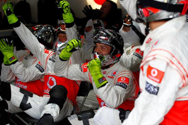 Nurburgring, Germany.24th July 2011.McLaren mechanics celebrate as their man Lewis Hamilton, McLaren MP4-26 Mercedes, 1st position, takes the lead. Portrait. World Copyright: Steven Tee/LAT Photographicref: Digital Image _A8C7772