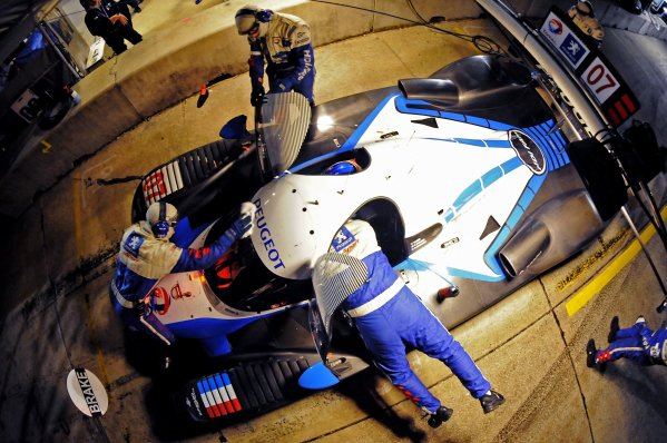 12-15 March 2008, Sebring, Florida, USA The #07 Peugeot finishes a driver change during night practice. ©F.Peirce Williams 2008, USA  LAT Photographic