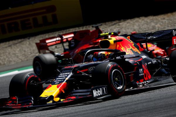 Pierre Gasly, Red Bull Racing RB15, leads Sebastian Vettel, Ferrari SF90