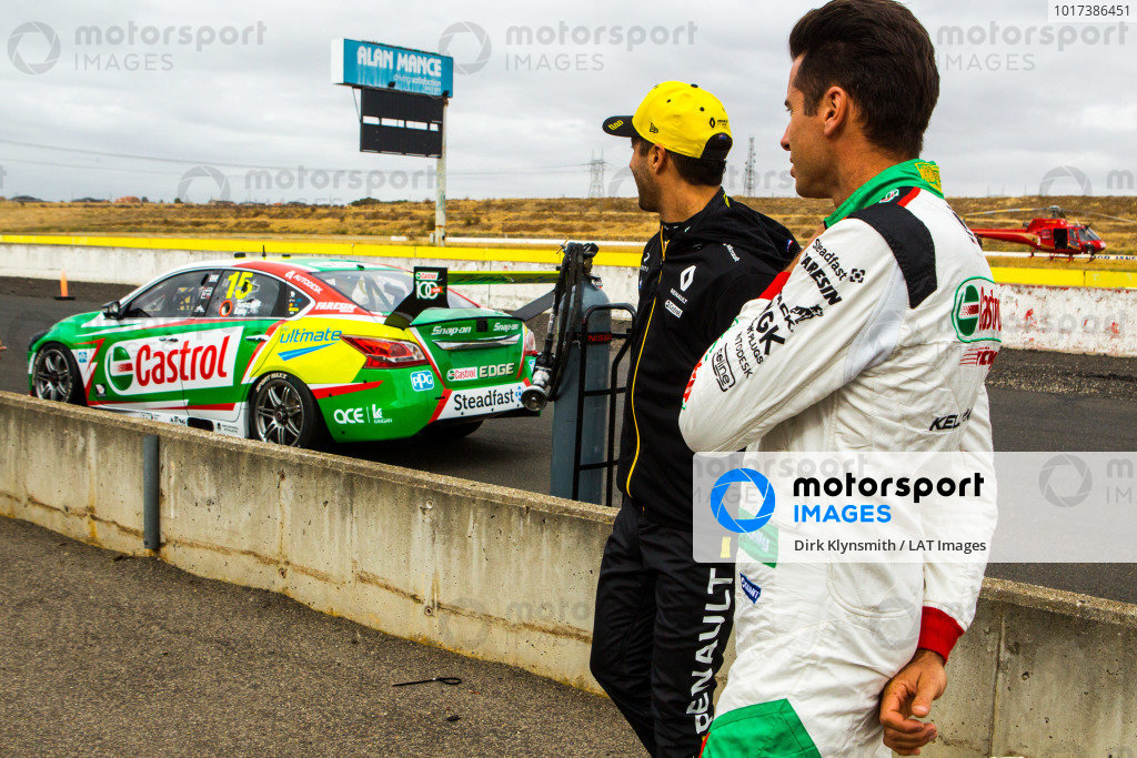 Daniel Ricciardo tests Kelly Racing Nissan Supercar at Calder, and stands in the pit lane next to Rick Kelly