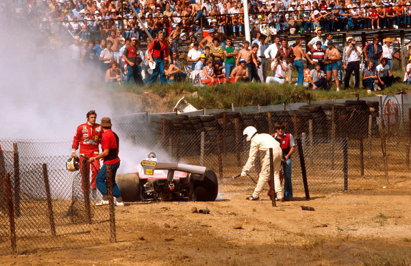 1978 South African Grand Prix.Kyalami, South Africa.2-4 March 1978.Carlos Reutemann (Ferrari 312T3) ended up in the catch-fencing after spinning off on the oil.Ref-78 SA 13.World Copyright - LAT Photographic