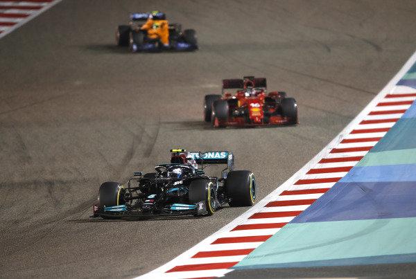Valtteri Bottas, Mercedes W12, leads Charles Leclerc, Ferrari SF21, and Lando Norris, McLaren MCL35M