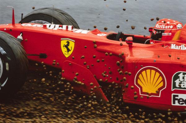 Michael Schumacher, Ferrari F2001, takes a trip through the gravel.