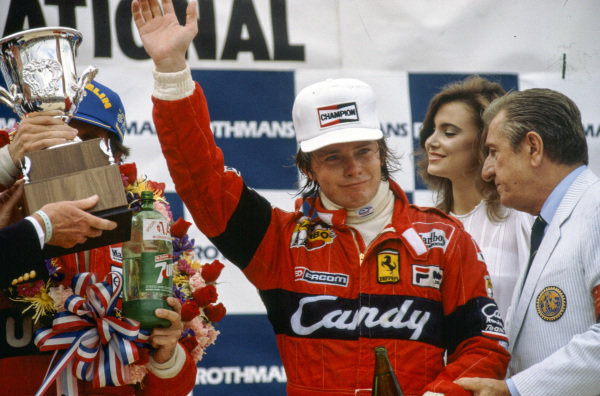 Didier Pironi, 3rd position, on the podium. Behind is Jean-Marie Balestre.