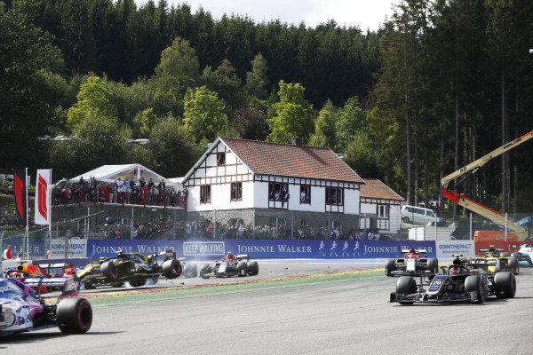 Daniel Ricciardo, Renault R.S.19, is hit on the opening lap as Kevin Magnussen, Haas VF-19 and Kimi Raikkonen, Alfa Romeo Racing C38 pass by