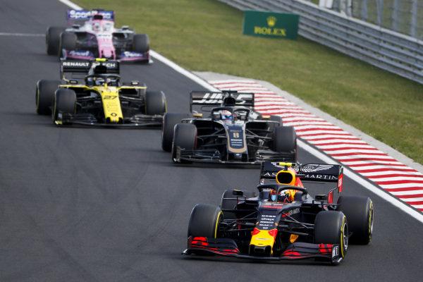 Pierre Gasly, Red Bull Racing RB15, leads Romain Grosjean, Haas VF-19, Nico Hulkenberg, Renault R.S. 19, and Sergio Perez, Racing Point RP19