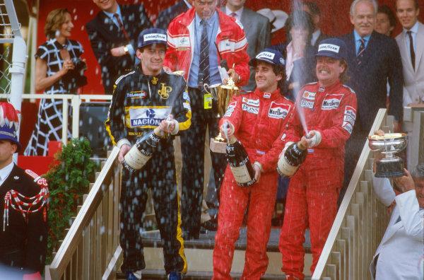 Monte Carlo, Monaco.8-11 May 1986.Alain Prost, 1st position, Keke Rosberg, 2nd position (both McLaren TAG Porsche) and Ayrton Senna (Team Lotus) 3rd position on the podium.Ref-86 MON 09.World Copyright - LAT Photographic