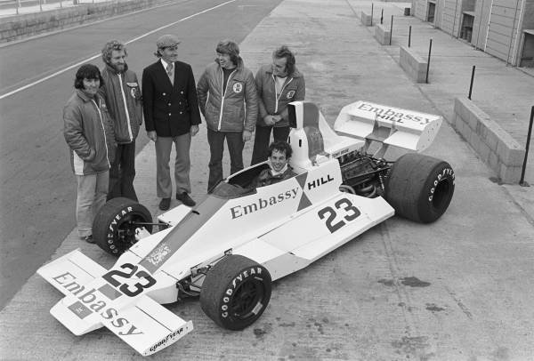 Launch of the Embassy Hill at Silverstone in 1975. Tony Brise seated in car, Graham Hill (in blazer) behind