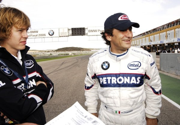 Alessandro Zanardi (ITA), right, with Sebastien Vettel (GER), BMW Sauber test driver, left.
