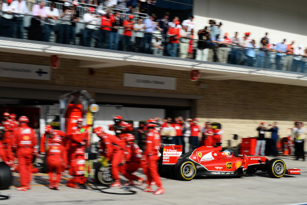 Fernando Alonso (ESP) Ferrari F14 T makes a pit stop. Formula One World Championship, Rd17, United States Grand Prix, Race, Austin, Texas, USA, Sunday 2 November 2014. BEST IMAGE