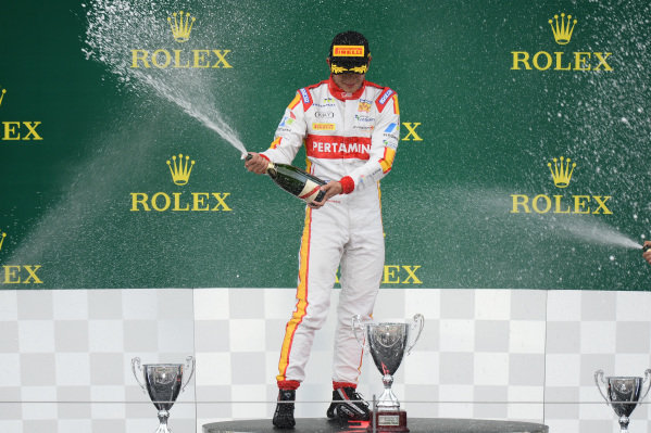 Race winner Rio Haryanto (INA) Trident celebrates on the podium with the champagne at GP2 Series, Rd4, Spielberg, Austria, 19-21 June 2015.