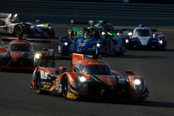 2015 FIA World Endurance Championship Bahrain 6-Hours Bahrain International Circuit, Bahrain Saturday 21 November 2015. Roman Rusinov, Julien Canal, Sam Bird (#26 LMP2 G-Drive Racing Ligier JS P2 Nissan) leads Gustavo Yacaman, Luis Felipe Derani, Ricardo Gonzalez (#28 LMP2 G-Drive Racing Ligier JS P2 Nissan) and Nelson Panciatici, Paul Loup Chatin, Tom Dillmann (#36 LMP2 Signatech Alpine Alpine A450B Nissan). World Copyright: Alastair Staley/LAT Photographic ref: Digital Image _79P0158