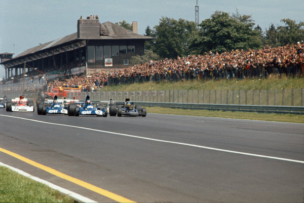 1973 German Grand Prix.  Nurburgring, Germany. 3-5th August 1973.  Jackie Stewart, Tyrrell 006 Ford, and Ronnie Peterson, Lotus 72E Ford, lead at the start.  Ref: 73GER20. World Copyright: LAT Photographic