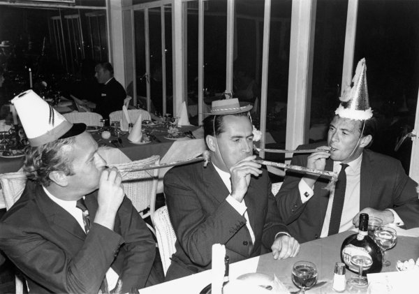 Kyalami, South Africa. 1st January 1968. Colin Chapman, Jack Brabham and Jim Clark celebrate Christmas at a Christmas party, portrait.  World Copyright:LAT Photographic. Ref: 1843 - 37A - 38