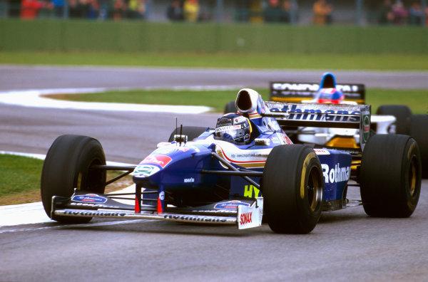 Imola, San Marino.25-27 APRIL 1997.Heinz-Harald Frentzen (Williams FW19 Renault) takes Traguardo on the way to his maiden F1 win.Ref-97 SM 04.World  Copyright - LAT Photographic