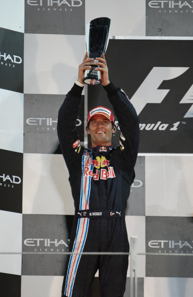 Yas Marina Circuit, Abu Dhabi, United Arab Emirates 1st November 2009. Mark Webber, Red Bull Racing RB5 Renault, 2nd position, celebrates on the podium. Portrait. Podium.  World Copyright: Steve Etherington/LAT Photographic ref: Digital Image SNE17981