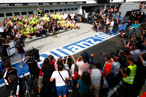 Hungaroring, Budapest, Hungary. Sunday 27 July 2014. Daniel Ricciardo, Red Bull Racing, 1st Position, and the Red Bull team celebrate victory. World Copyright: Andy Hone/LAT Photographic. ref: Digital Image _ONZ4964