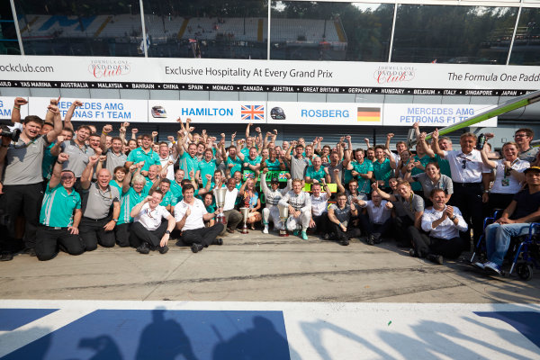 Autodromo Nazionale di Monza, Monza, Italy. Sunday 7 September 2014. Lewis Hamilton, Mercedes AMG, 1st Position, Nico Rosberg, Mercedes AMG, 2nd Position, Toto Wolff, Executive Director (Business), Mercedes AMG, Paddy Lowe, Executive Director (Technical), Mercedes AMG, and the Mercedes AMG team celebrate.  World Copyright: Steve Etherington/LAT Photographic. ref: Digital Image SNE28615