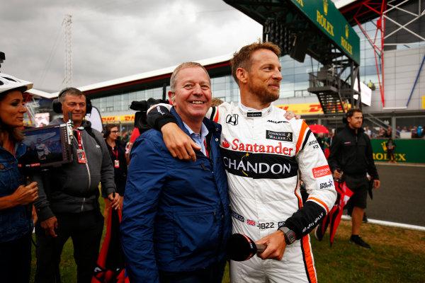 Silverstone, Northamptonshire, UK.  Thursday 13 July 2017. Jenson Button embraces Sky pundit Martin Brundle. World Copyright: Andy Hone/LAT Images  ref: Digital Image _ONZ3331
