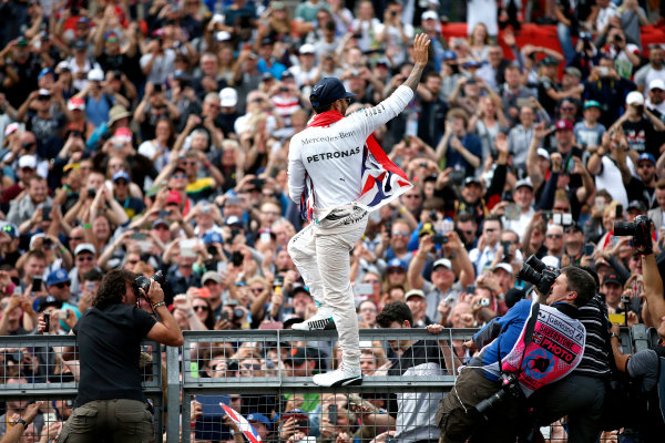Silverstone, Northamptonshire, UK Sunday 10 July 2016. Lewis Hamilton, Mercedes AMG, 1st Position, celebrates victory at his home race with the fans. World Copyright: Dunbar/LAT Photographic ref: Digital Image _W2Q5484A