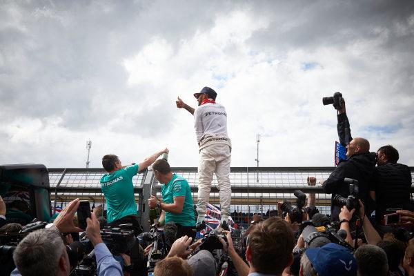 Silverstone, Northamptonshire, UK Sunday 10 July 2016. Lewis Hamilton, Mercedes AMG, 1st Position, celebrates with the fans after the race. World Copyright: Steve Etherington/LAT Photographic ref: Digital Image SNE21900