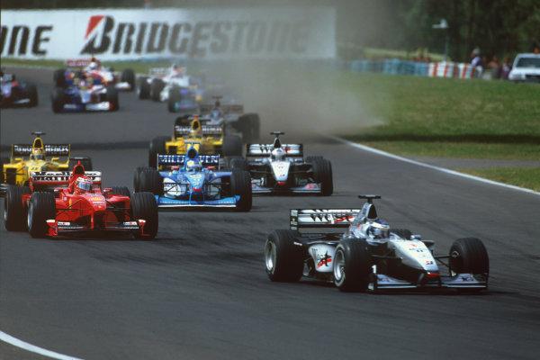 Hungaroring, Budapest, Hungary. 13-15 August 1999. Mika Hakkinen (McLaren MP4/14 Mercedes), 1st position, leads Eddie Irvine (Ferrari F399), 3rd position, at the start, action. World Copyright: LAT Photographic.Ref:  99HUN a