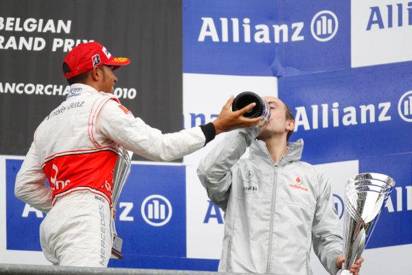 Spa-Francorchamps, Spa, Belgium 29th August 2010 Lewis Hamilton, McLaren MP4-25 Mercedes, 1st position, and Phil Prew, Race Engineer, McLaren, celebrate on the podium. Portrait. Podium.  World Copyright: Charles Coates/LAT Photographic ref: Digital Image _G7C0704