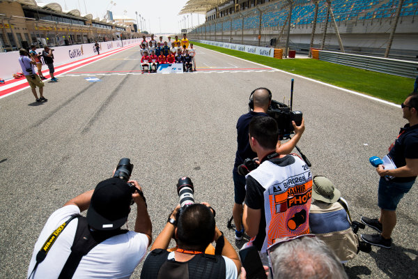 2017 FIA Formula 2 Round 1. Bahrain International Circuit, Sakhir, Bahrain.  Thursday 13 April 2017. Class photo on the grid. Photo: Sam Bloxham/FIA Formula 2. ref: Digital Image _J6I8309