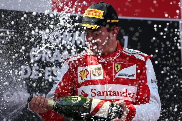 Race winner Fernando Alonso (ESP) Ferrari celebrates on the podium with the champagne. Formula One World Championship, Rd5, Spanish Grand Prix, Race Day, Barcelona, Spain, Sunday 12 May 2013.