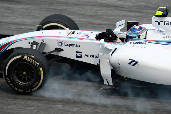 Valtteri Bottas (FIN) Williams FW36 locks up. Formula One World Championship, Rd2, Malaysian Grand Prix, Practice, Sepang, Malaysia, Friday 28 March 2014.
