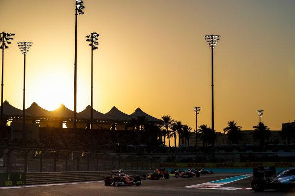 Yas Marina Circuit, Abu Dhabi, United Arab Emirates. Sunday 27 November 2016. Kimi Raikkonen, Ferrari SF16-H, leads Daniel Ricciardo, Red Bull Racing RB12 TAG Heuer. World Copyright: Dunbar/LAT Photographic ref: Digital Image _X4I4651