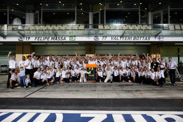 Yas Marina Circuit, Abu Dhabi, United Arab Emirates. Sunday 23 November 2014. The Williams team celebrate securing third in the Constructors Championship. World Copyright: Glenn Dunbar/LAT Photographic. ref: Digital Image _W2Q7488
