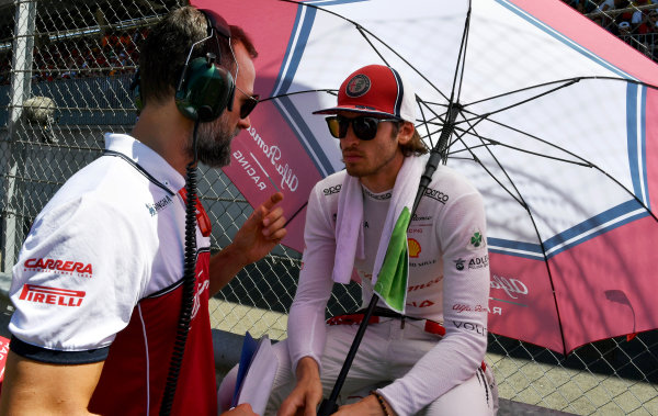 Antonio Giovinazzi speaks to an enginer on the grid before the race